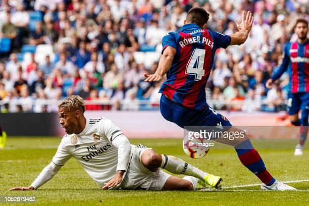 Mariano Diaz of Real Madrid and Rober Pier of Levante battle for the ball during the La Liga match between Real Madrid CF and Levante UD at Estadio...