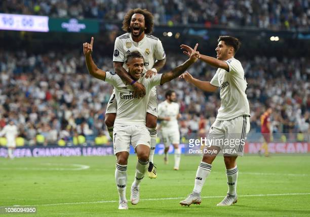 Mariano Diaz of Real Madrid celebrates after scoring his team's third goal with Marcelo of Real Madrid during the Group G match of the UEFA Champions...