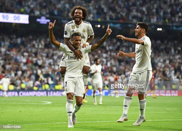 Mariano Diaz of Real Madrid celebrates with Marcelo and Marco Asensio after scoring his team's third goal during the Group G match of the UEFA...