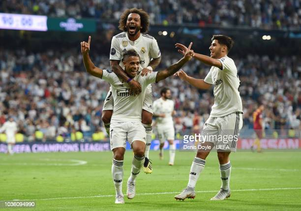 Mariano Diaz of Real Madrid celebrates with teammates after scoring his team's third goal during the Group G match of the UEFA Champions League...