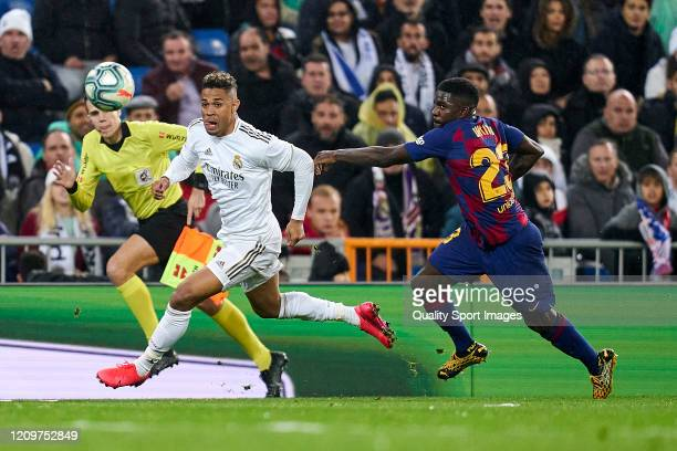 Mariano Diaz of Real MAdrid CF battle for the ball with Samuel Umtiti of FC Barcelona during the Liga match between Real Madrid CF and FC Barcelona...