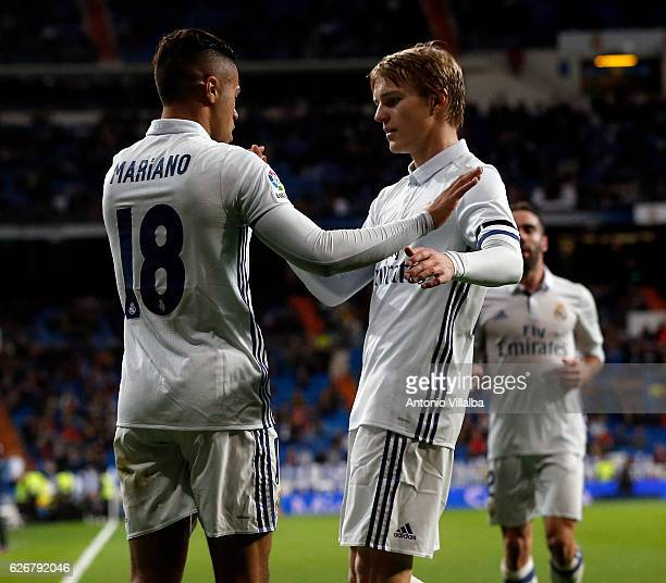 Mariano Diaz of Real Madrid CF celebrates after scoring Real's 3rd goal whit is teammates Marin Odegaard during the Copa del Rey last of 32 match...