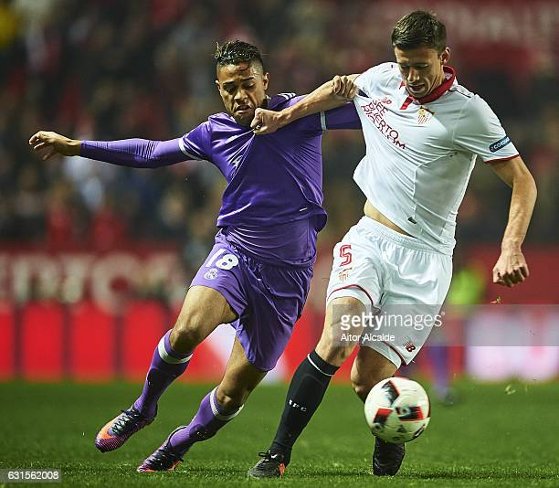 Mariano Diaz of Real Madrid CF competes for the ball with Clement Lenglet of Sevilla FC during the Copa del Rey Round of 16 Second Leg match between...