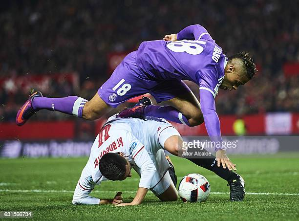 Mariano Diaz of Real Madrid CF competes for the ball with Matias Kranevitter of Sevilla FC during the Copa del Rey Round of 16 Second Leg match...