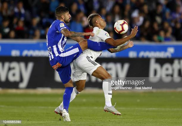 Mariano Diaz of Real Madrid competes for the ball with Guillermo Maripan of Deportivo Alaves during the La Liga match between Deportivo Alaves and...