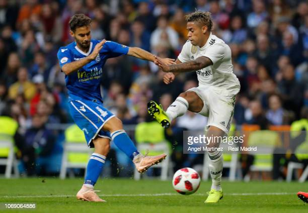 Mariano Diaz of Real Madrid competes for the ball with Jordi Ortega of Melilla during the Copa del Rey fourth round second leg match between Real...
