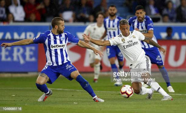Mariano Diaz of Real Madrid competes for the ball with Victor Laguardia of Deportivo Alaves during the La Liga match between Deportivo Alaves and...