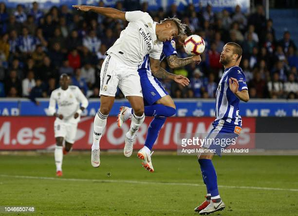 Mariano Diaz of Real Madrid competes for the ball with Ximo Navarro of Deportivo Alaves during the La Liga match between Deportivo Alaves and Real...
