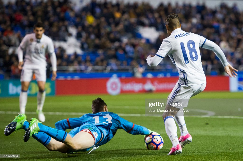 Mariano Diaz of Real Madrid duels for the ball with Przemys¸aw Tyton of RC Deportivo La Coruna during the La Liga match between RC Deportivo La Coruna and Real Madrid at Riazor Stadium on April 26, 2017 in La Coruna, Spain.