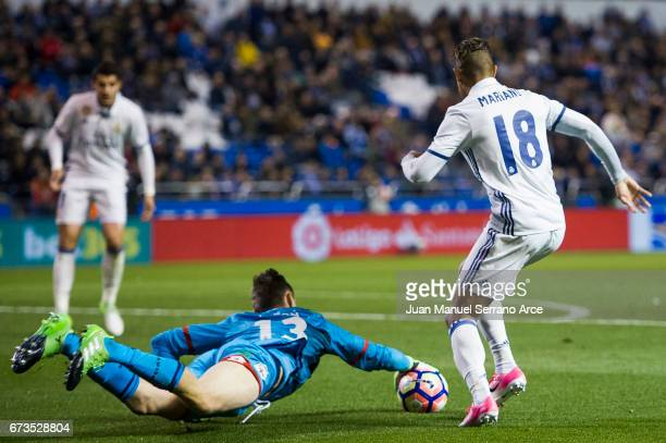 Mariano Diaz of Real Madrid duels for the ball with Przemys¸aw Tyton of RC Deportivo La Coruna during the La Liga match between RC Deportivo La...