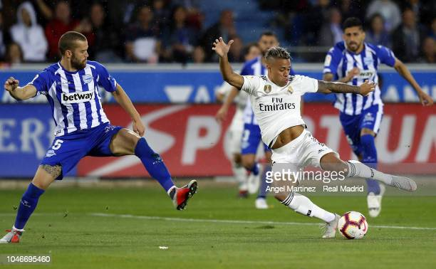 Mariano Diaz of Real Madrid is challenged by Victor Laguardia of Deportivo Alaves during the La Liga match between Deportivo Alaves and Real Madrid...
