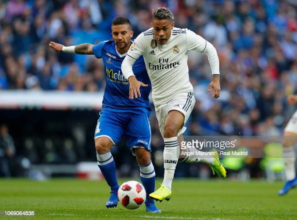 Mariano Diaz of Real Madrid is chased by Juan Ramon Ruano of Melilla during the Copa del Rey fourth round second leg match between Real Madrid and...