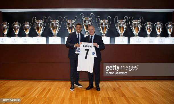 Mariano Diaz of Real Madrid poses with President Florentino Perez during his official presentation at Santiago Bernabeu stadium on August 31 2018 in...