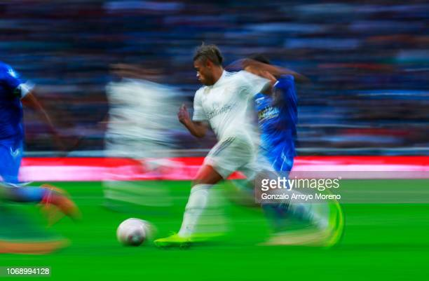 Mariano Diaz of Real Madrid runs with the ball during the Copa del Rey fourth round match between Real Madrid and Melilla at Estadio Bernabeu on...
