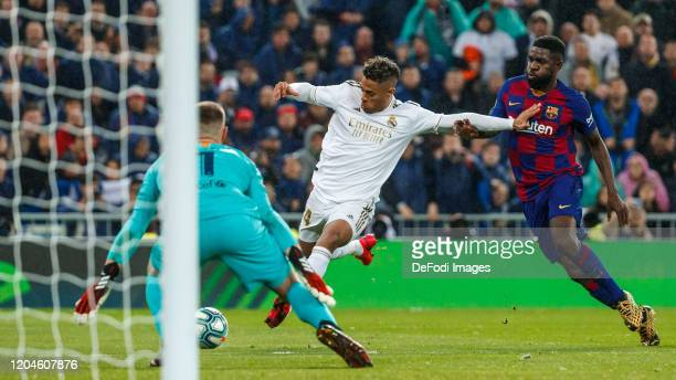 Mariano Diaz of Real Madrid Samuel Umtiti and Ter Stege of FC Barcelona controls the ball during the Liga match between Real Madrid CF and FC...
