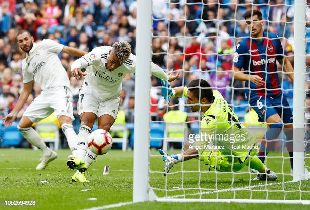 Mariano Diaz of Real Madrid scores a disallowed goal past Oier Olazabal of Levante UD during the La Liga match between Real Madrid CF and Levante UD...