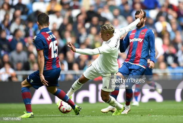 Mariano Diaz of Real Madrid takes on the Levante defence during the La Liga match between Real Madrid CF and Levante UD at Estadio Santiago Bernabeu...
