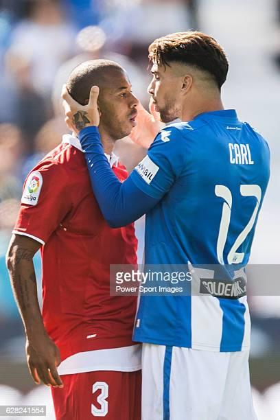 Mariano Ferreira Filho of Sevilla FC clashes with Carl Medjani of Deportivo Leganes as Ruben Perez of Deportivo Leganes is injured during their La...