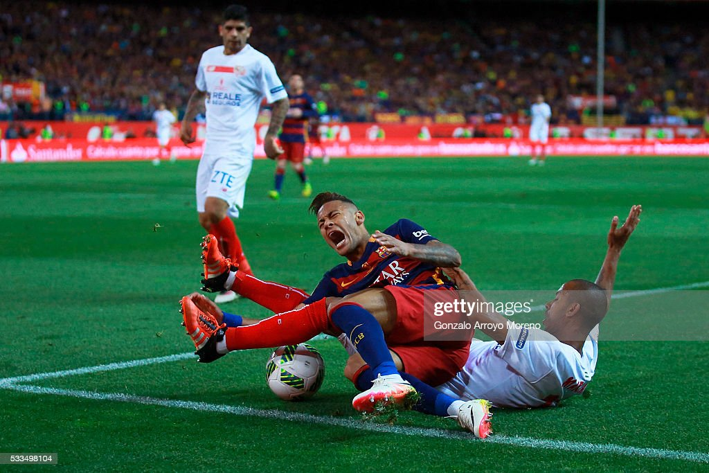 Mariano Ferreira Filho (R) of Sevilla FC tackles Neymar JR. (L) of FC Barcelona during the Copa del Rey Final match between FC Barcelona and Sevilla FC at Vicente Calderon Stadium on May 22, 2016 in Madrid, Spain.