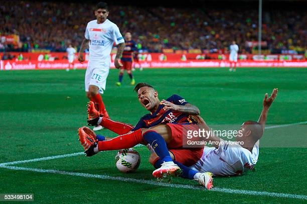 Mariano Ferreira Filho of Sevilla FC tackles Neymar JR of FC Barcelona during the Copa del Rey Final match between FC Barcelona and Sevilla FC at...