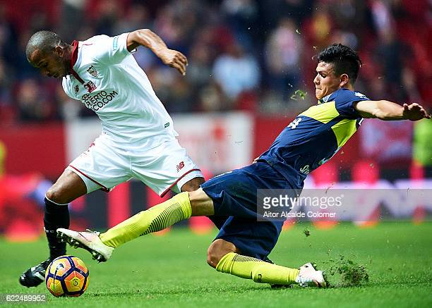 Mariano Ferreira of Sevilla FC competes for the ball with Jonathan Silva of Boca Juniors during the match between Sevilla FC vs Boca Juniors as part...