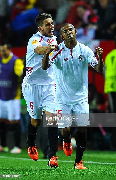 Mariano Ferreria of Sevilla FC celebrates with his teammate Daniel Filipe Martins Carrico of Sevilla FC after scoring his team's third goal during...