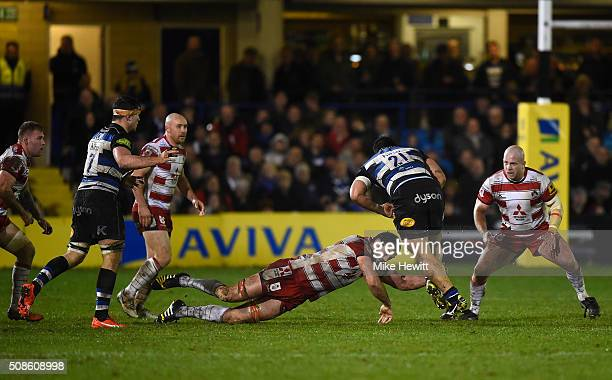 Mariano Galarza of Gloucester attempts to tackle Alafoti Faosiliva of Bath during the Aviva Premiership match between Bath and Gloucester at the...
