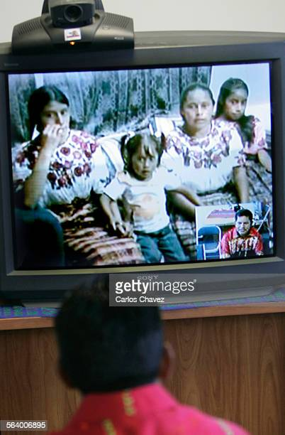 Mariano Gonzalez talks with his family in Quetzaltenango Guatemala during a video conference from Amingo Latino in Los Angeles Sunday Videoconference...