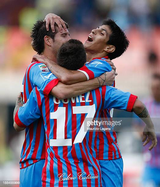 Mariano Izco Alejandro Gomez and Pablo Barrientos of Catania celebrate the third goal during the Serie A match between Calcio Catania and SS Lazio at...