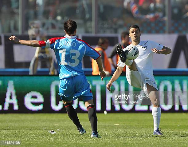 Mariano Izco of Catania competes for the ball with Antonio Candreva of Lazio during the Serie A match between Catania Calcio and SS Lazio at Stadio...