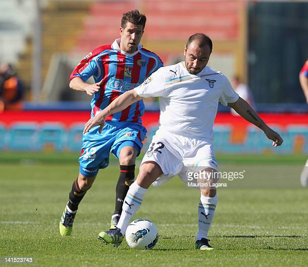 Mariano Izco of Catania competes for the ball with Cristian Brocchi of Lazio during the Serie A match between Catania Calcio and SS Lazio at Stadio...