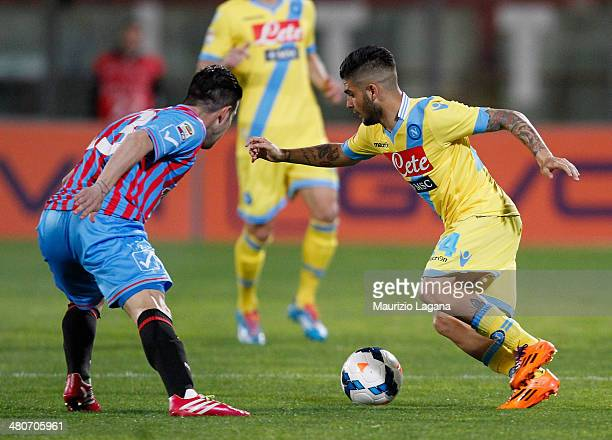 Mariano Izco of Catania competes for the ball with Lorenzo Insigne of Napoli during the Serie A match between Calcio Catania and SSC Napoli at Stadio...