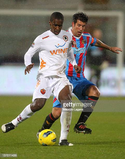 Mariano Izco of Catania competes for the ball with Silveira Juan of Roma during the Serie A match between Catania Calcio v AS Roma at Stadio Angelo...