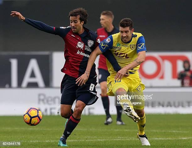 Mariano Izco of Chievo competes for the ball with Davide Di Gennaro of Cagliari during the Serie A match between AC ChievoVerona and Cagliari Calcio...