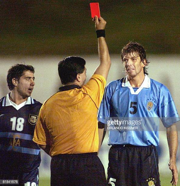 Mariano Messera of the Argentinian soccer team observed the referee, Byron Moreno expel Gabriel Garcia of Uruguay from the game 04 February, 2000 in...