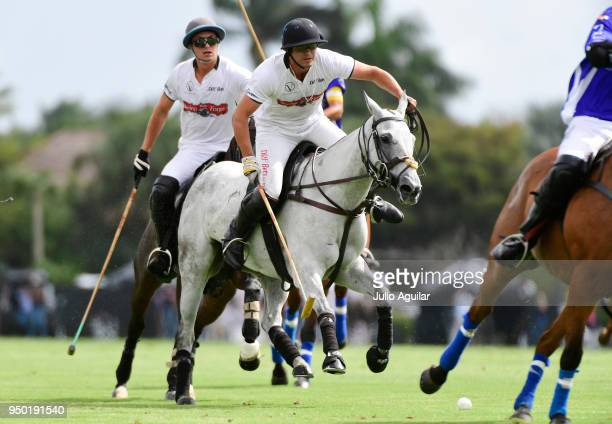 Mariano Obregon of The Daily Racing Form looks for a path through Valiente defenders in the US Open Polo Championship April 22 2018 in Wellington...