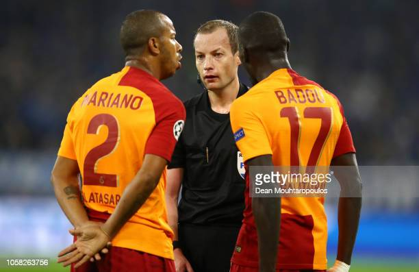 Mariano of Galatasaray and Badou Ndiaye of Galatasaray speaks to referee William Collum during the Group D match of the UEFA Champions League between...