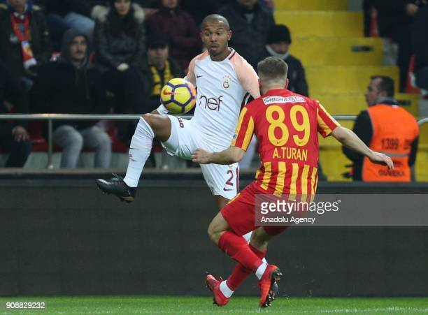Mariano of Galatasaray in action against Atilla Turan of Kayserispor during the Turkish Super Lig match between Kayserispor and Galatasaray at...