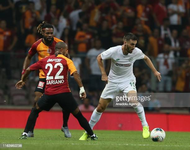Mariano of Galatasaray in action against Riad Bajic of Konyaspor during the Turkish Super Lig soccer match between Galatasaray and Konyaspor at Turk...
