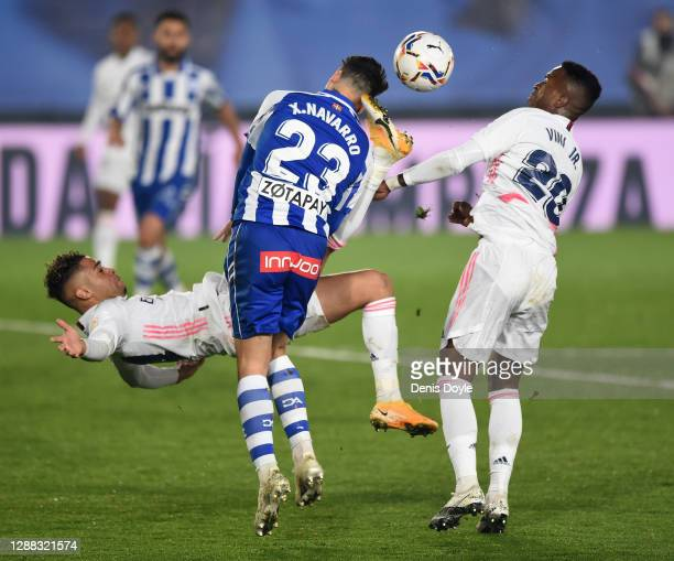 Mariano of Real Madrid attempts an over-head kick and kicks Ximo Navarro of Deportivo Alaves in the head during the La Liga Santander match between...