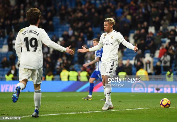 Mariano of Real Madrid celebrates after scoring his team's third goal with Alvaro Odriozola during the La Liga match between Real Madrid CF and...