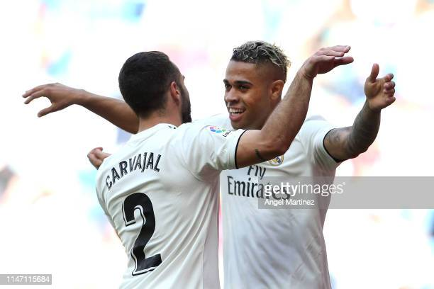 Mariano of Real Madrid celebrates after scoring his team's third goal with Daniel Carvajal during the La Liga match between Real Madrid CF and...