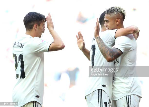 Mariano of Real Madrid celebrates after scoring his team's third goal with Lucas Vazquez and Brahim Diaz during the La Liga match between Real Madrid...
