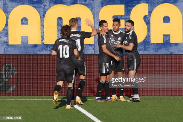 Mariano of Real Madrid celebrates with teammates after scoring his team's first goal during the La Liga Santander match between Villarreal CF and...