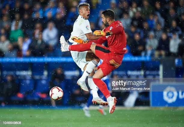 Mariano of Real Madrid CF competes for the ball with Fernando Pacheco of Deportivo Alaves during the La Liga match between Deportivo Alaves and Real...