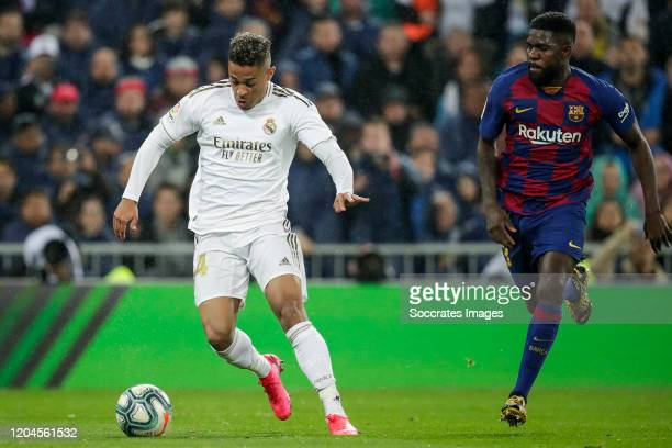 Mariano of Real Madrid Samuel Umtiti of FC Barcelona during the La Liga Santander match between Real Madrid v FC Barcelona at the Santiago Bernabeu...