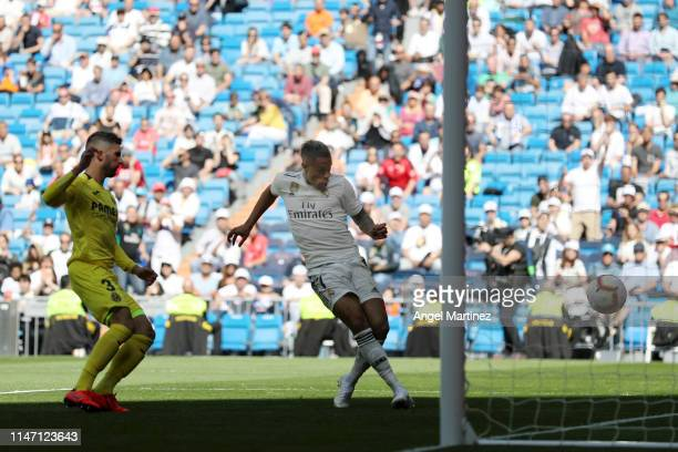 Mariano of Real Madrid scores his team's third goal during the La Liga match between Real Madrid CF and Villarreal CF at Estadio Santiago Bernabeu on...