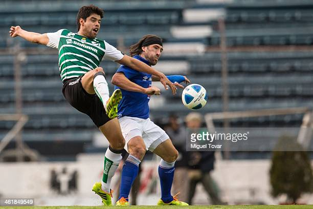 Mariano Pavone of Cruz Azul fights for the ball with Nestor Araujo of Santos during a match between Cruz Azul and Santos Laguna as part of the...