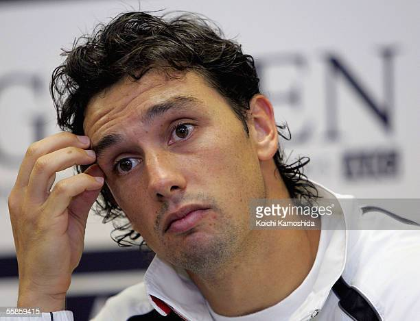 Mariano Puerta of Argentina speaks during a press conference following his match against Marcos Baghdatis of Cyprus at the AIG Japan Open Tennis...