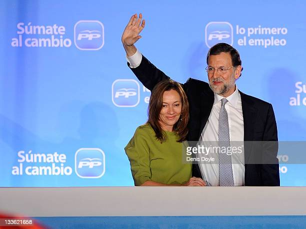 Mariano Rajoy leader of the Popular Party is accompanied by his wife Elvira Fernandez while addressing party supporters after winning the Spanish...